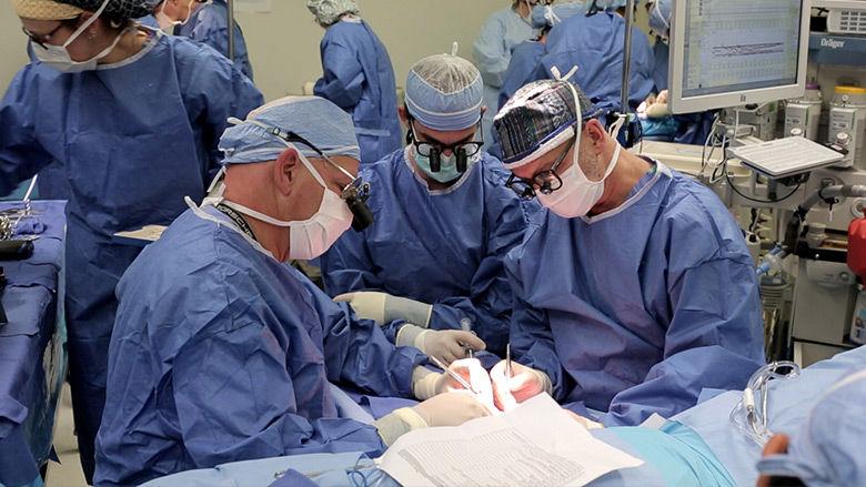 Surgeons Performing Hand Transplant Surgery
