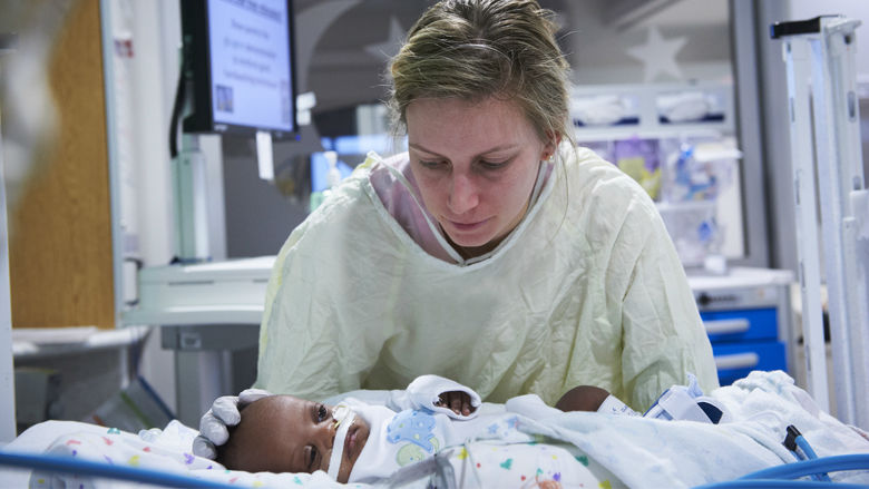 Nurse in N/ICCU with infant