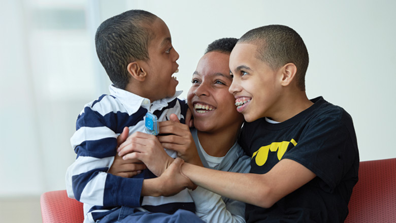 Mom with 2 sons smiling