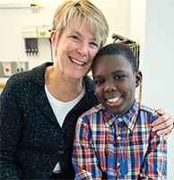 Carlyle Glah, LSW, MSW,who works with patients awaiting kidney transplants and their parents, with kidney transplant patient Samad, 10. Social workers play a pivotal role with Nephrology patients, whether they are experiencing an acute episode or require
