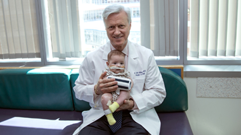 Dr Adzick holding a baby with HI