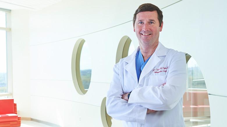 Dr. Flynn Smiling in Lab Coat