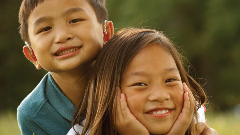 boy hugging girl and smiling