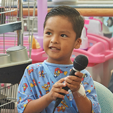 Young boy holding microphone
