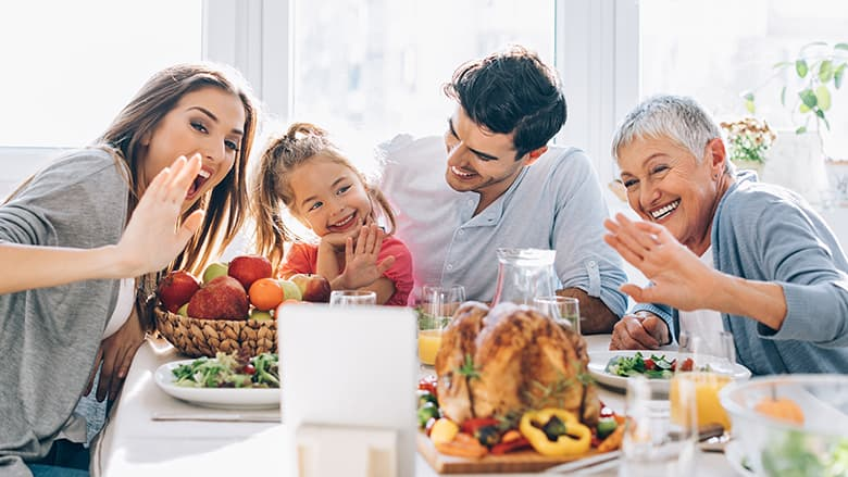 Family doing a video call at Thanksgiving table