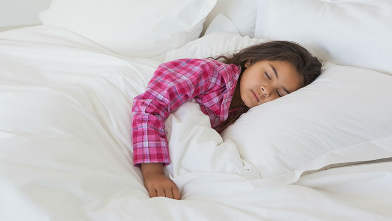 Older female toddler sleeping in bed