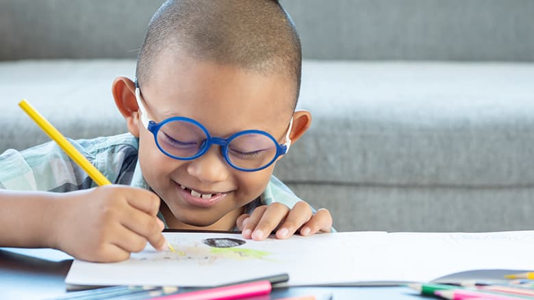 Young boy drawing a picture