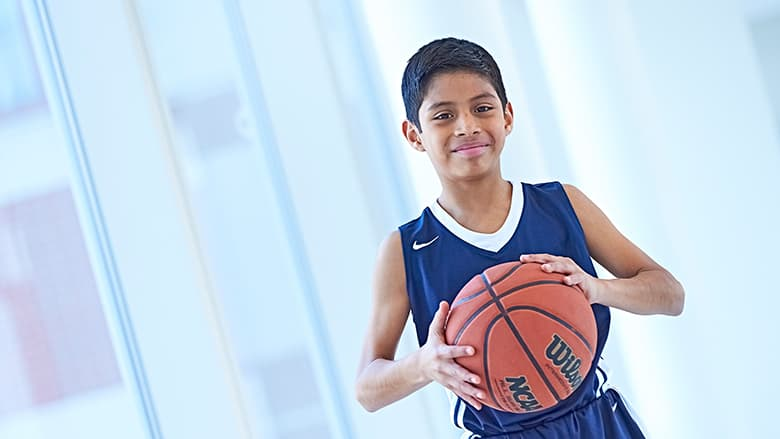 Young boy in his basketball uniform