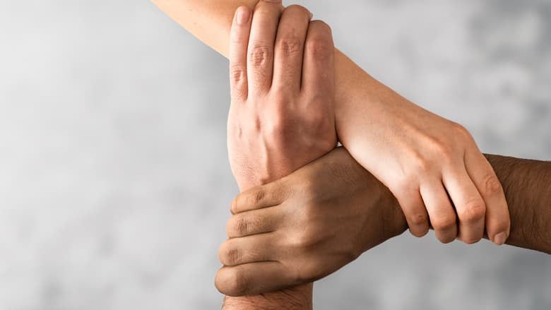 Hands of different races held together
