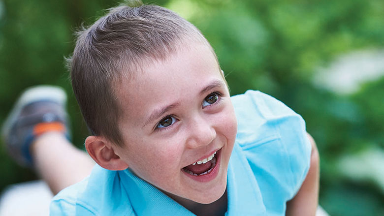 Max oncology patient smiling playing outside