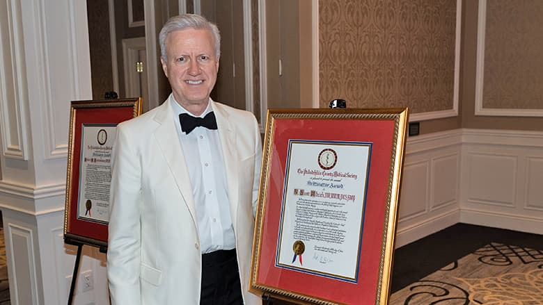 Dr. Adzick with his award