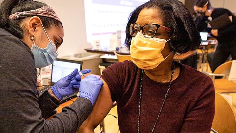 CHOP employee receives COVID-19 vaccine