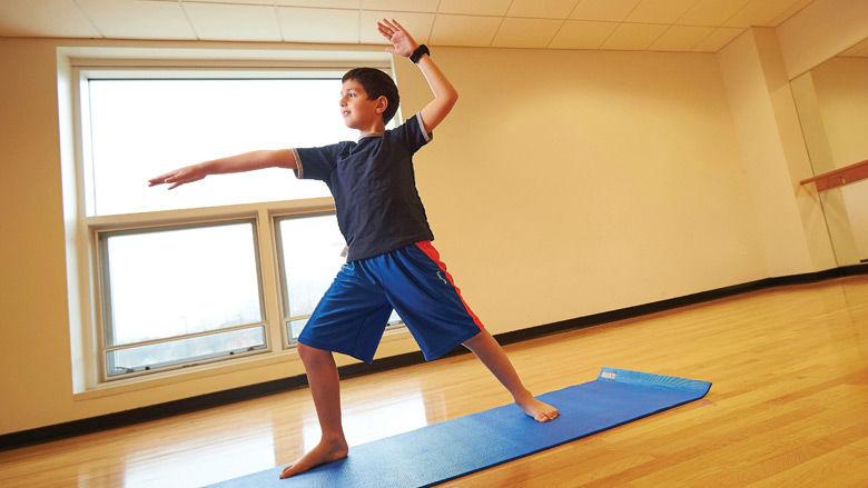 boy practicing yoga