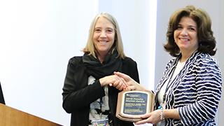 Dr. Zemel receiving her award