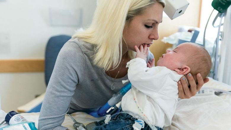 Kristen holding her son, Vinny