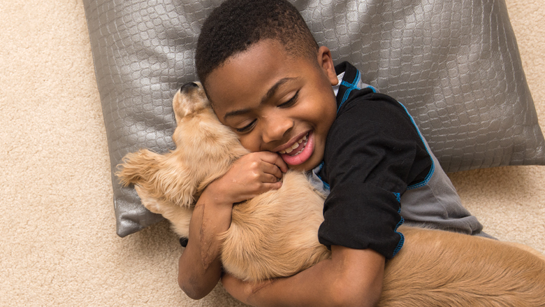 Zion hugging a puppy