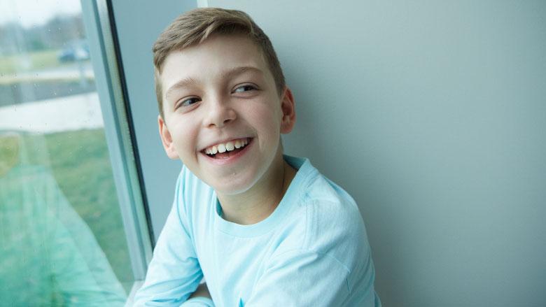 boy hospital patient smiling in window