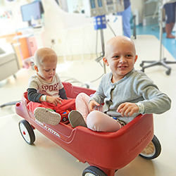 Two kids with cancer in a wagon at KOP Specialty Care Center
