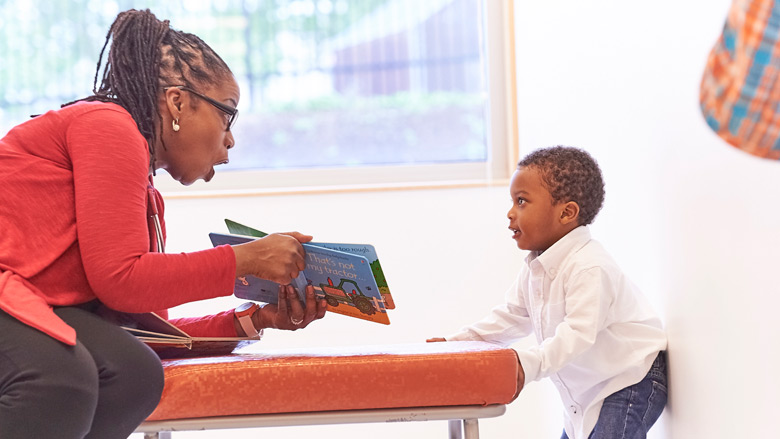 Mom reading to a young child