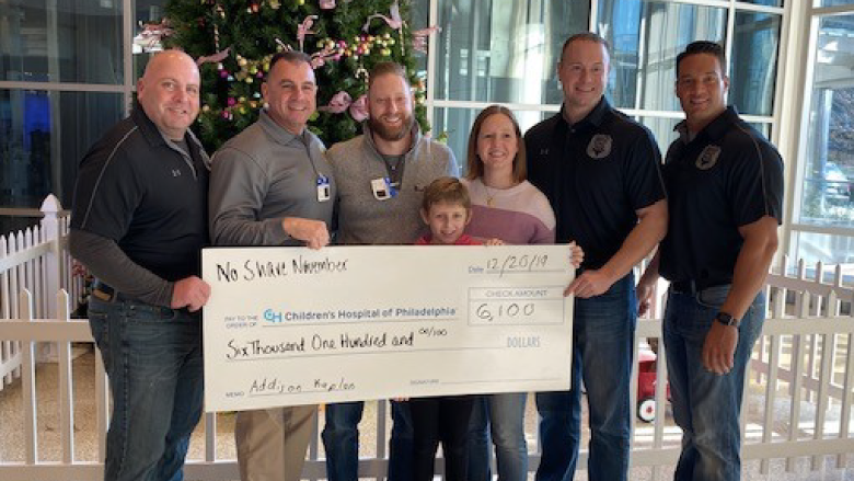 Addison and Marlboro police department members with fundraiser check