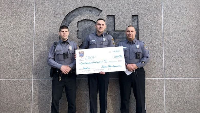 Riverton Police Association holding check in front of hospital