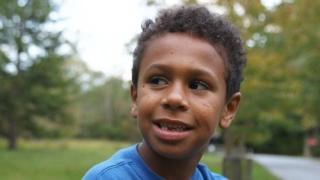 Preteen boy smiling