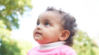 infant girl looking upward