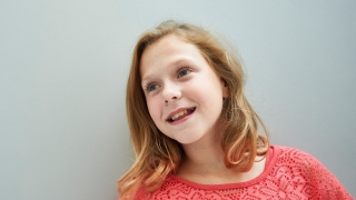 pre-teen girl smiling