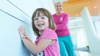 Girl smiling with Medical Professional