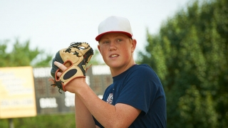 teen with baseball glove