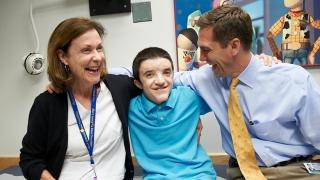smiling plastics patient with parents