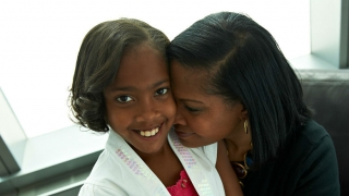 daughter and mother hugging