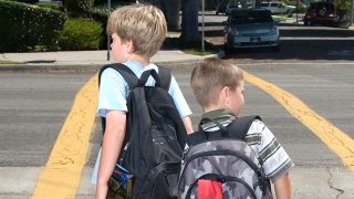 Student walking home from school with backpack