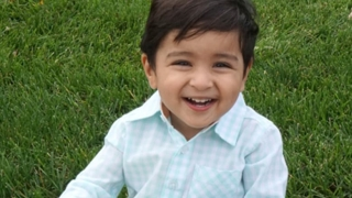 Izahd sitting in grass