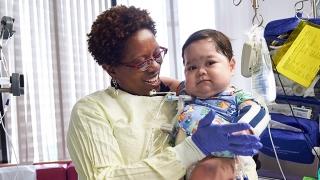 APP nurse at the main hospital holding a baby