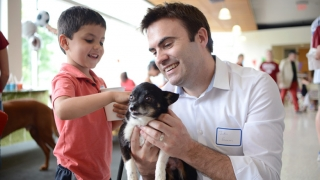Child with Volunteer and Puppy