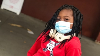Dallas wearing a protective mask and headphones
