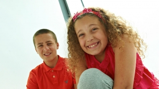 Girl and boy smiling