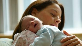 Mom holding infant