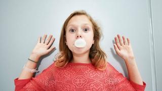 Farrah blowing a bubble with bubble gum
