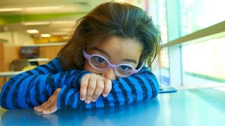 Shy young girl with glasses