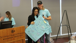 Celiac doctor Ritu Verma, is honored with a t-shirt signed by all of her patients