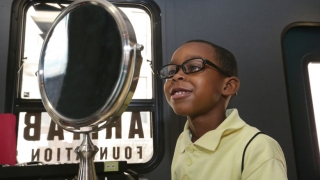 Child chooses glasses after eye exam