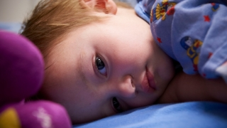 Child in hospital laying down