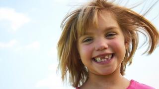 Child outside smiling