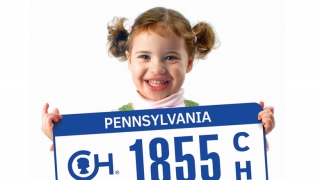 girl holding chop specialty license plate