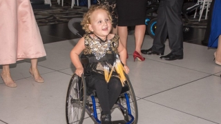 Claire on the dance floor in her wheelchair dancing