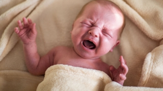 infant with colic crying