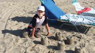 Connor playing in the sand at the beach