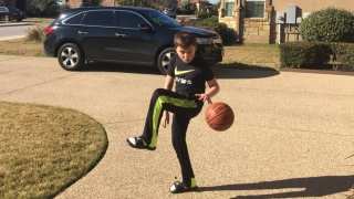 Connor playing basketball